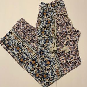 Loose fitting floral pants with tassel ties